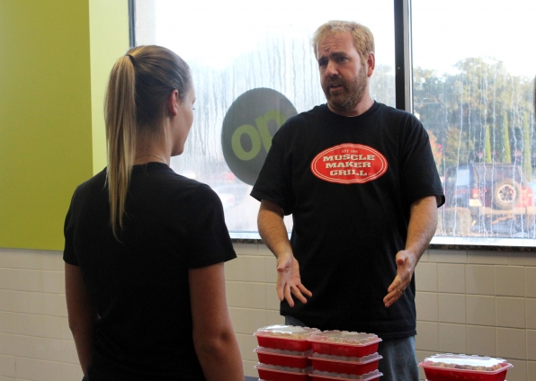 Tim learns about Muscle Maker Grill's meal-plan program.