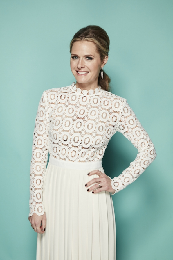 Maggie Lawson looks white-hot in this floor-length cream gown