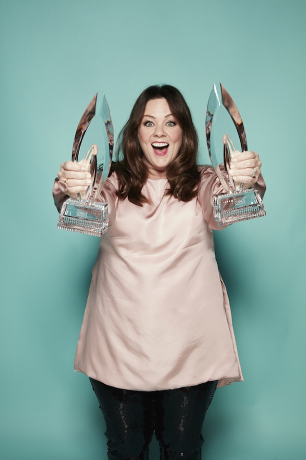 Melissa McCarthy has her hands full at the PCAs