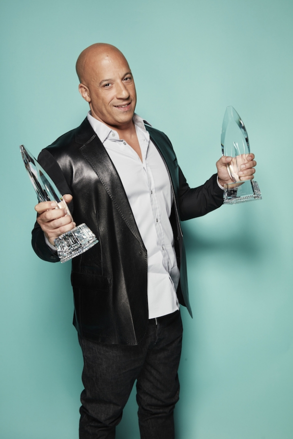 Vin Diesel holds one PCA in each hand