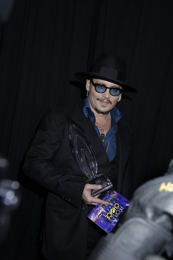 Johnny Depp sneaks a smile in after his PCA win