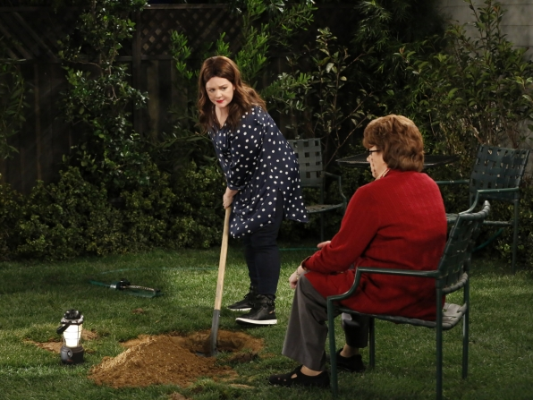 Peggy instructs Molly on where—and how—to dig a hole in the backyard.