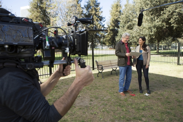 James Brolin and Angelique Cabral go over their lines before a scene on Life In Pieces.