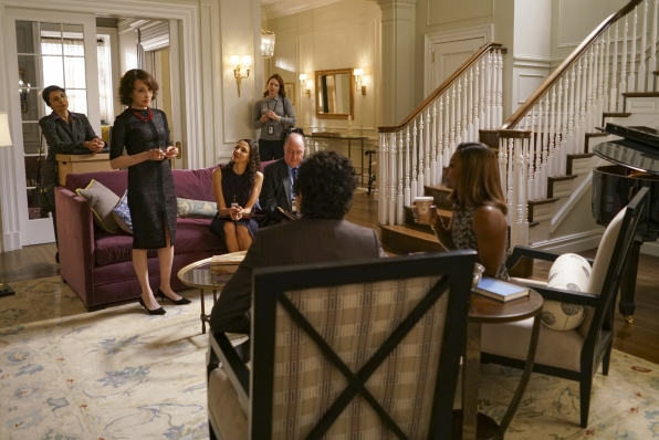 Elizabeth's team gathers at her private residence.