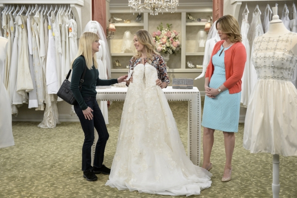 Christy is happy to treat her daughter, Violet, to her wedding dress.