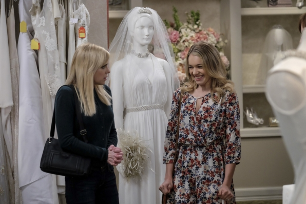 Violet is giddy about the thought of trying on her dream wedding dress with Christy.