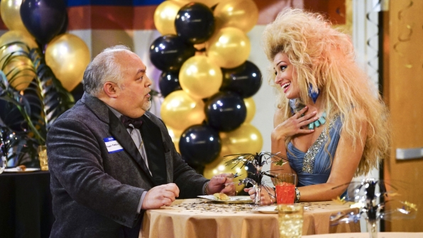 Caroline tries to charm Angie's twin brother, Angelo, with sequins and a smile.