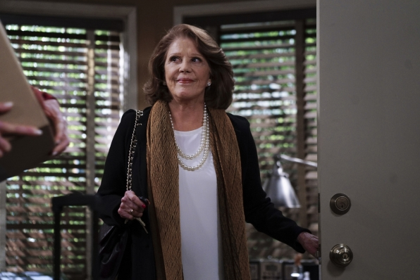 Gregory's mother opens the door for Bonnie and Christy.