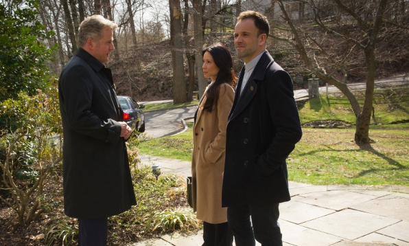 Aidan Quinn as Captain Tommy Gregson, Lucy Liu as Joan Watson, and Jonny Lee Miller as Sherlock Holmes