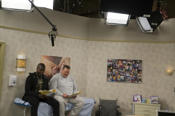Stars Reno Wilson and Mike Gardell rehearse their lines in a hospital room on-set.