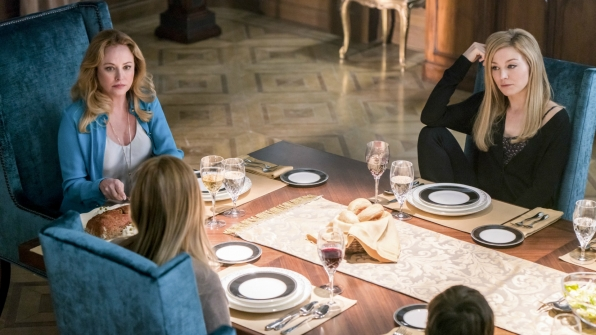 Madeline sits down to dinner with her children.