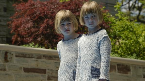 The twins watch Jack outside.