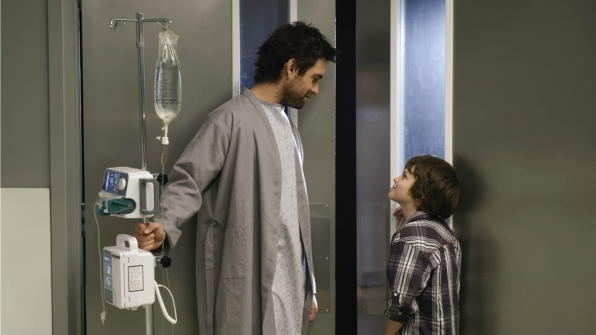Garrett is visited by Jack in the hospital.