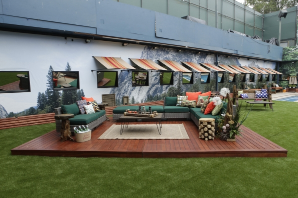 The Houseguests will celebrate great outdoors in this woodsy backyard expanse.