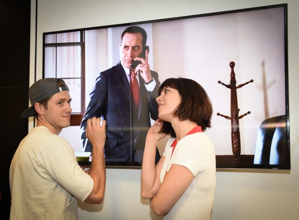 Aaron Tveit and Mary Elizabeth Winstead goof around under the big screen.
