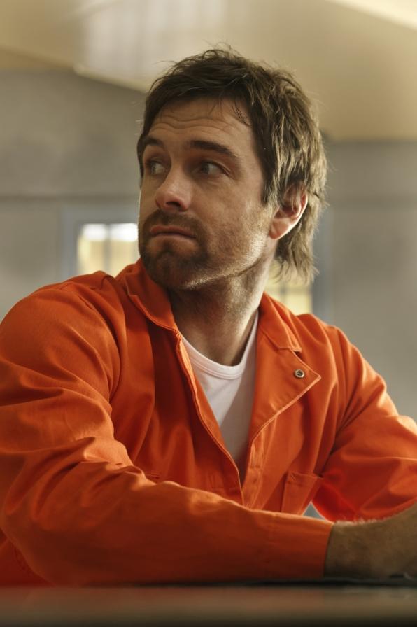 Garrett looks over his shoulder in prison.