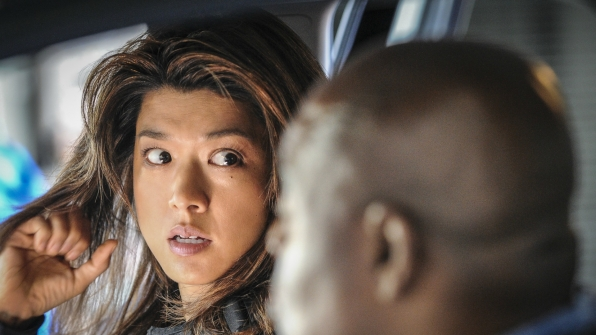 Kono and Grover exchange a knowing look.
