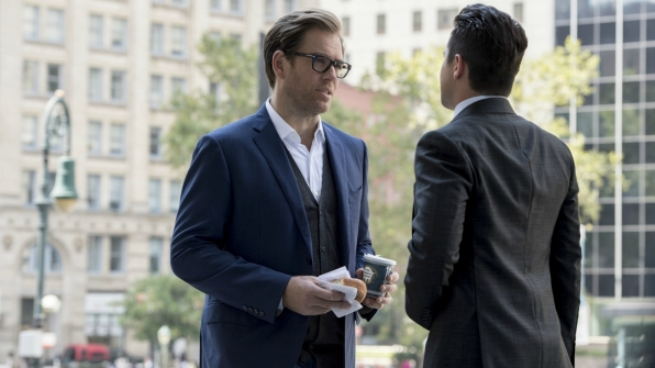 Dr. Bull and Benny have a side conversation outside the courthouse.