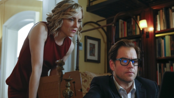 Marissa looks over Bull's shoulder while reading new information.