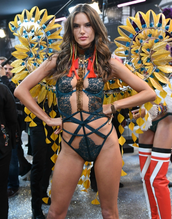 Angel Alessandra Ambrosio shows off her ornate yellow wings.