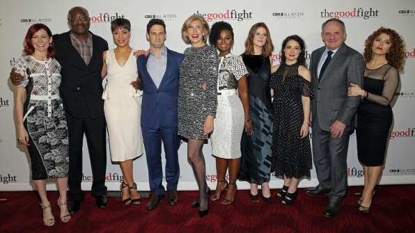 The Good Fight cast poses together for a glamorous group shot before entering the theater.