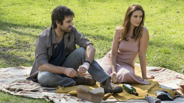 Garrett and Christina picnic in the sun.