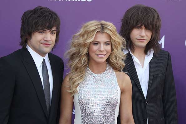 Kimberly Perry (with brothers Reid and Neil) of The Band Perry shimmered at the 48th Annual Academy of Country Music Awards.