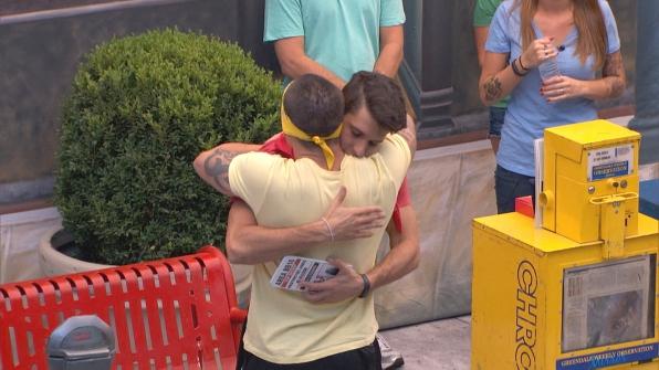 Caleb hugs Cody