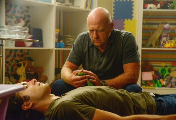 "Alexander Koch as Junior Rennie and Dean Norris as James ""Big Jim"" Rennie."