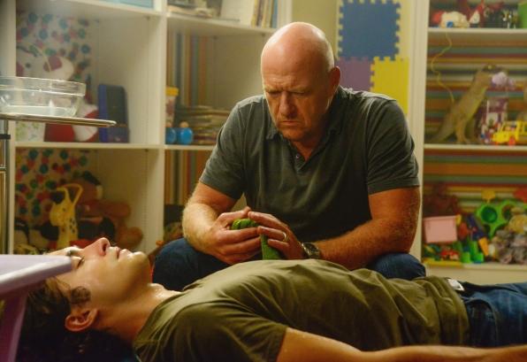 "Alexander Koch as Junior Rennie and Dean Norris as James ""Big Jim"" Rennie."