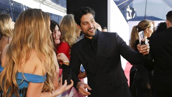 Adam Rodriguez delivers a few soon-to-be profile pictures with fans.