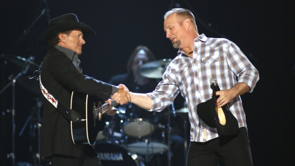 "31. Garth Brooks and George Strait perform ""The Dance"" and ""The Cowboy Rides Away"" in tribute to Dick Clark at the 48th ACM Awards in 2013."