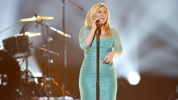 "6. Kelly Clarkson performs ""Don't Rush"" at the 48th ACM Awards in 2013."
