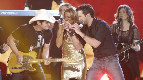 "9. Brad Paisley, Luke Bryan, and Sheryl Crow perform ""Boys 'Round Here"" at the 48th ACM Awards in 2013."
