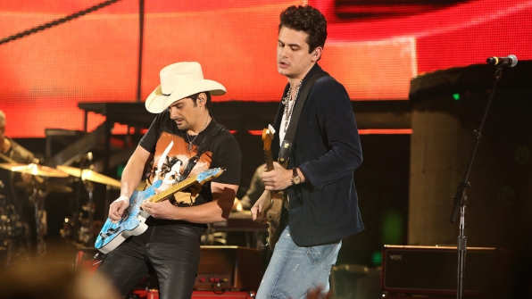 "2. Brad Paisley and John Mayer perform ""Beat This Summer"" at the 48th ACM Awards in 2013."
