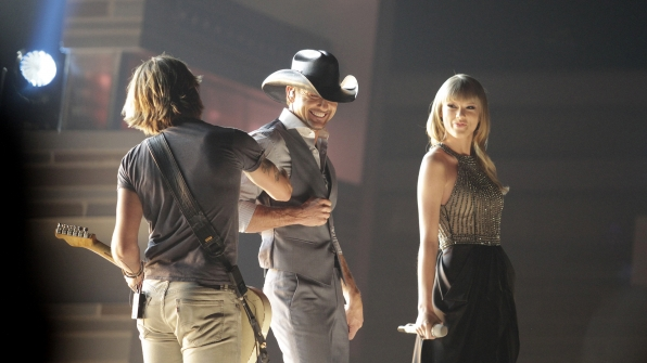 """26. Tim McGraw, Taylor Swift, and Keith Urban perform """"Highway Don't Care"""" at the 48th ACM Awards in 2013."""