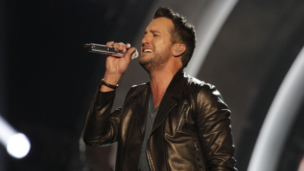 """36. Luke Bryan performs """"Play It Again"""" at the 49th ACM Awards in 2014."""