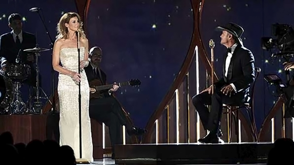 "20. Faith Hill and Tim McGraw perform ""Meanwhile Back At Mama's"" at the 49th ACM Awards in 2014."