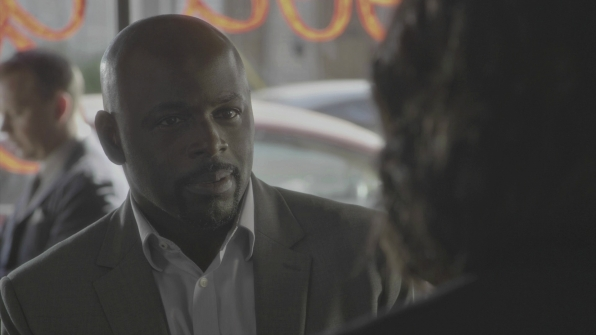 Dr. Lewis meets a man claiming to be her brother in a diner.
