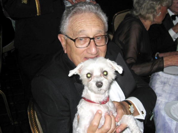 1. Henry Kissinger With a Dog in Headlights