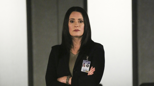 Unit Chief Emily Prentiss looks on.