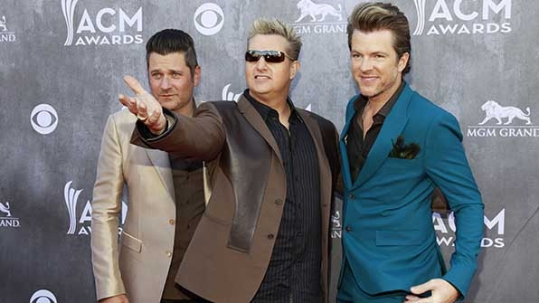 Jay DeMarcus, Gary LeVox, and Joe Don Rooney of Rascal Flatts formed a  fashion trifecta at the 49th Annual Academy of Country Music Awards.