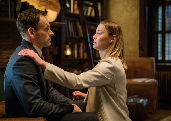 Jonny Lee Miller as Sherlock Holmes and Betty Gilpin as Fiona Helbron