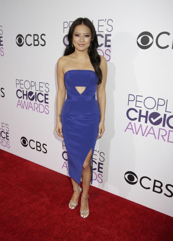 Christine Ko beamed in a cobalt blue dress with sparkling silver heels.