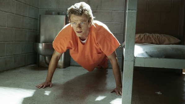 MacGyver does pushups in his cell.