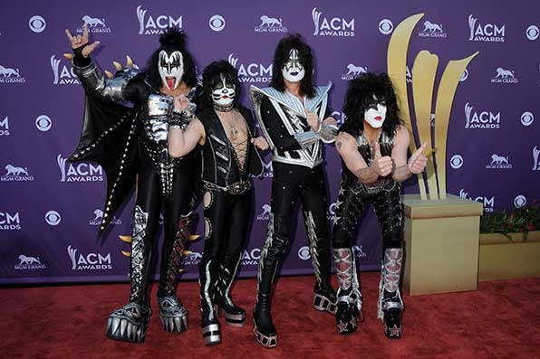 Gene Simmons, Eric Singer, Tommy Thayer, and Paul Stanley of KISS added a little leather to the carpet at the 2012 ACMs.