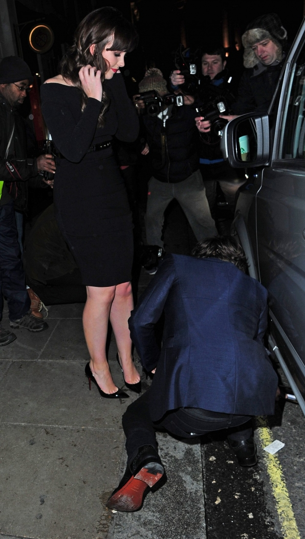 Harry even reaches under the car to retrieve the phone.