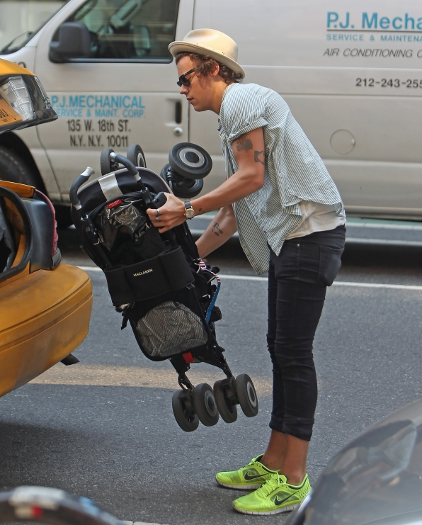 Harry helps by loading the Corden family stroller in the cab.