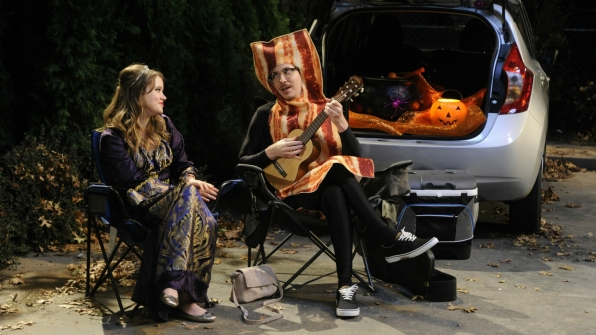 Chale serenades Kendra while the kids Trunk-or-Treat.