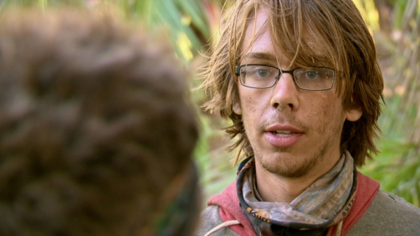 Will, the youngest competitor of the season, talks with a fellow castaway.